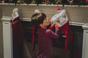 Little boy looking into a Christmas stocking