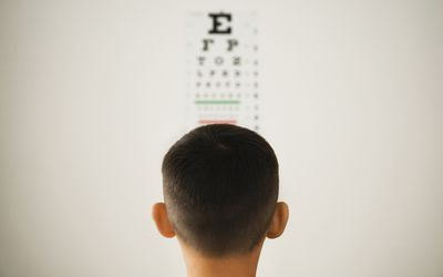 A child stares at a vision test.