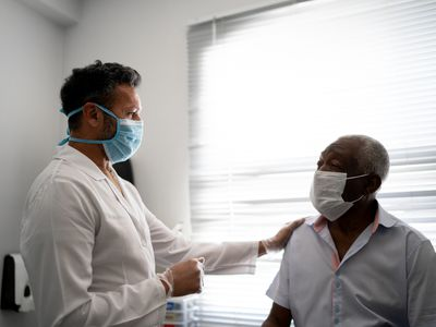 doctor giving emotional support to a patient