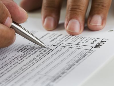 a closeup of a person doing their taxes