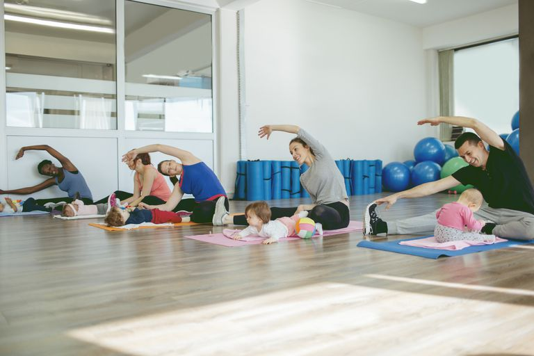Parents taking exercise class with their babies