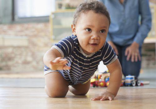 A BIPOC baby crawling
