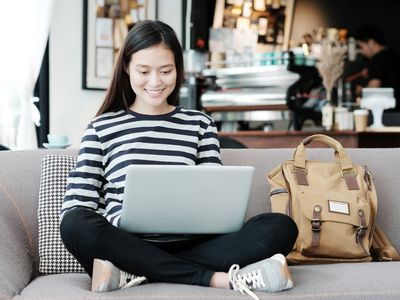 young teen on a laptop