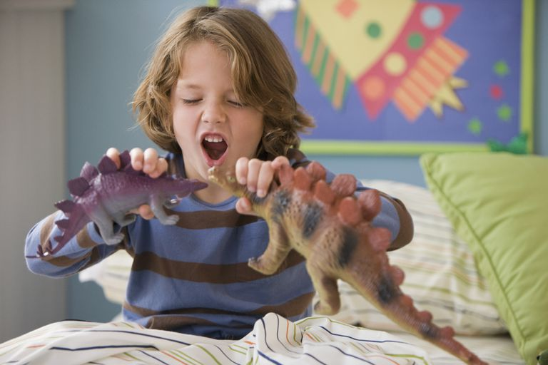 dawdling - boy playing with dinosaurs