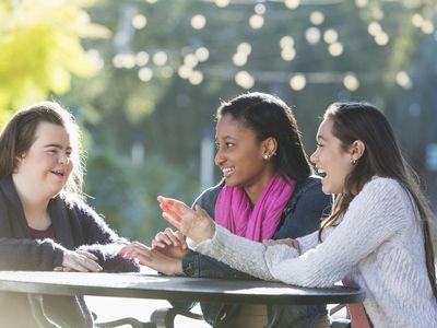 Three teenage friends talking