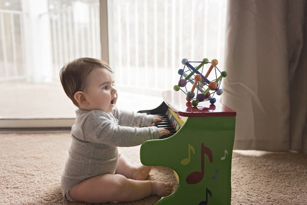 Baby playing toy piano
