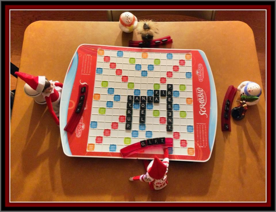 Elf on the Shelf playing Scrabble