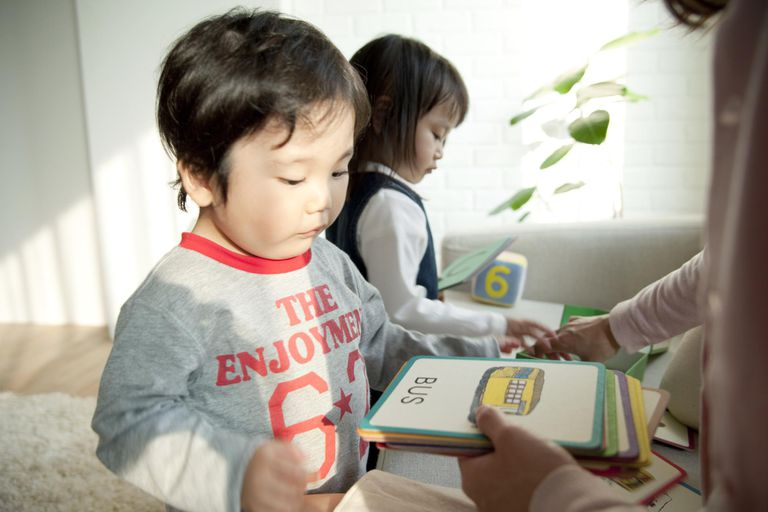 Mother teaching children with flash cards