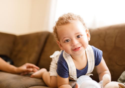 toddler boy with big eyes and a smile