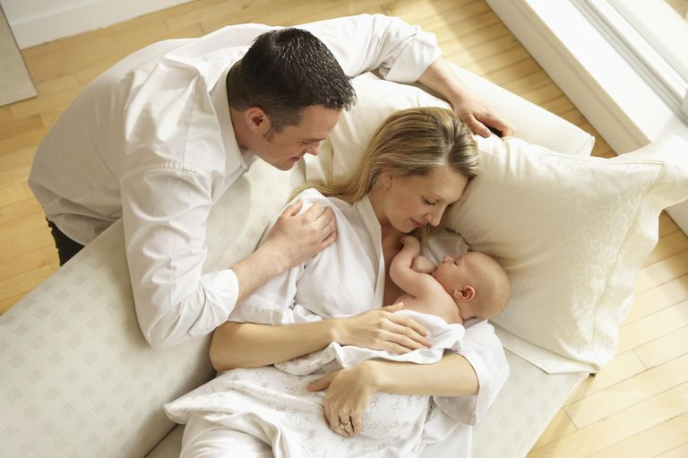 Father and Mother Watching Baby Sleeping.