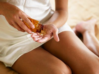 Woman holding vitamins