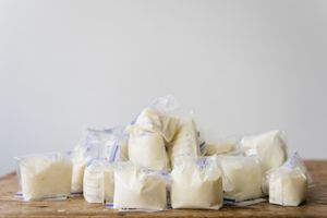 Bags of frozen breast milk on table
