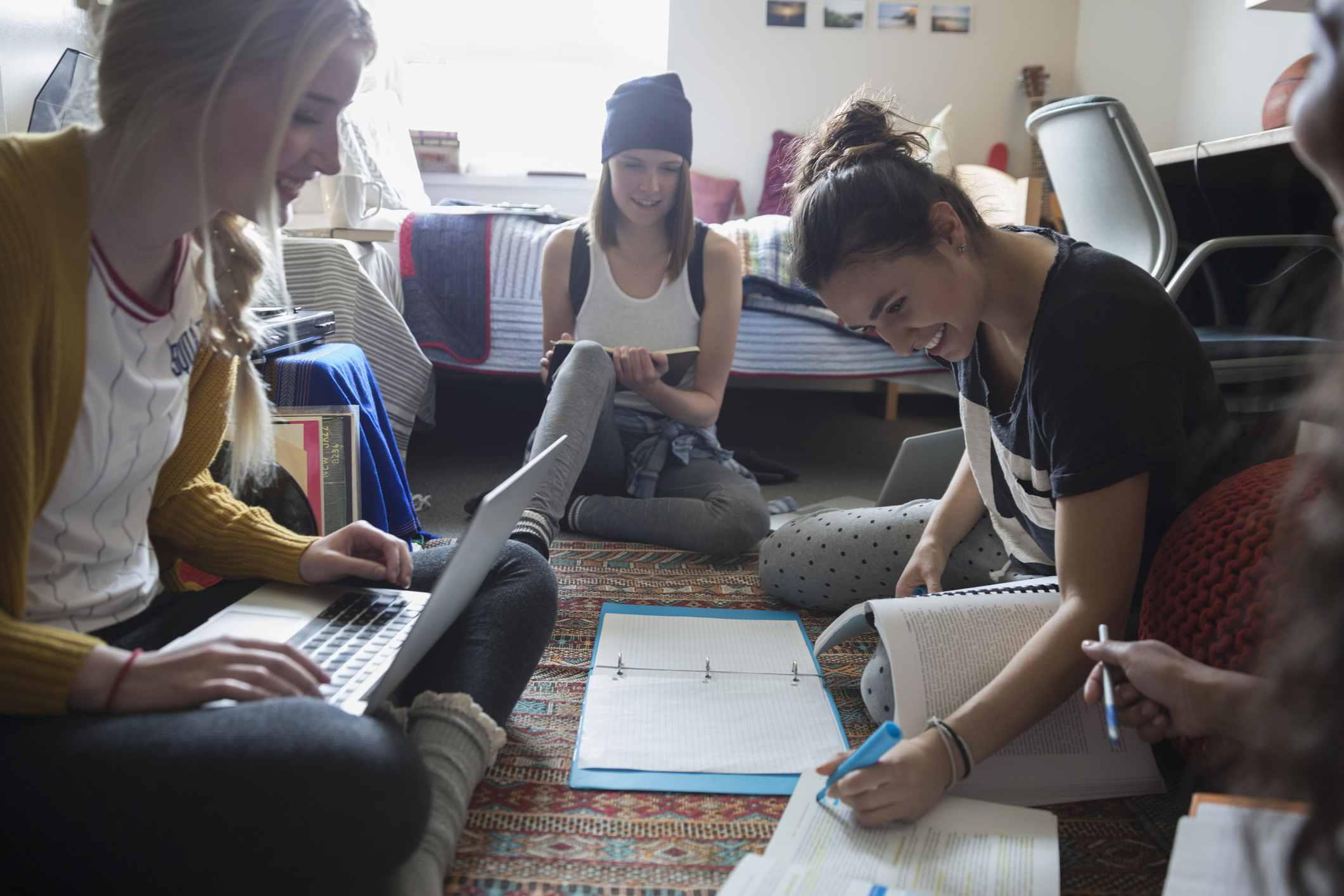 Group of women studying in a dorm room