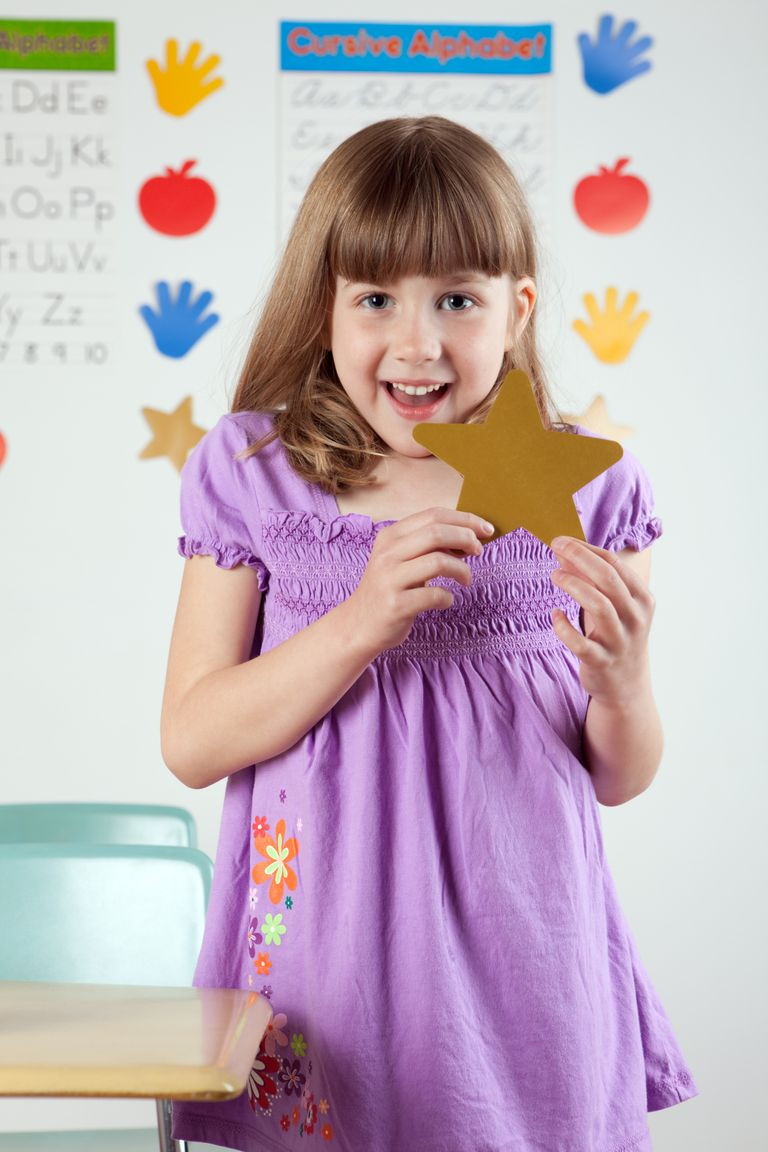 young girl with gold star in classroom