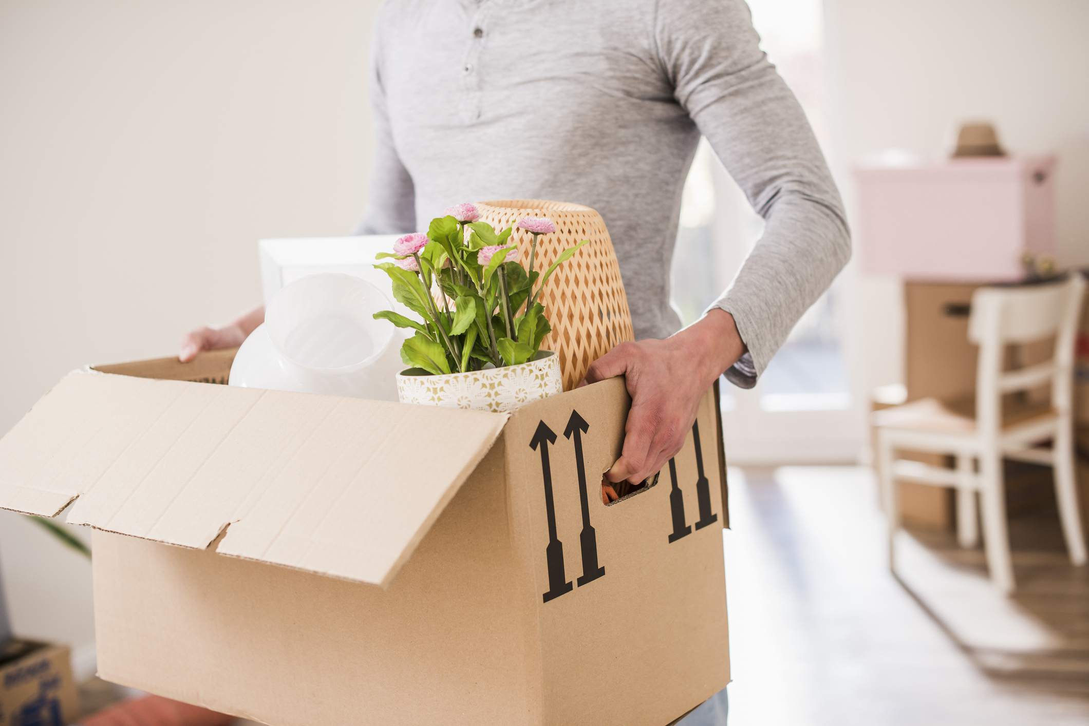 Homeowner moving a box