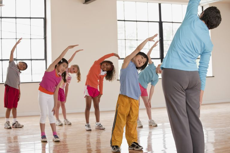 5 year old child development - kids stretching in gym class