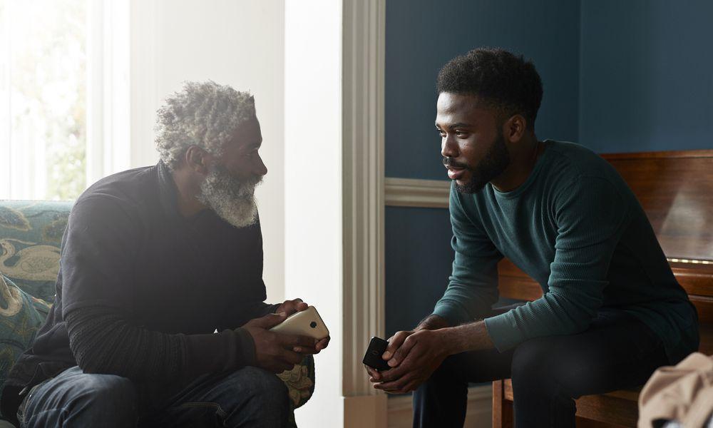 Adult kid speaking with parent