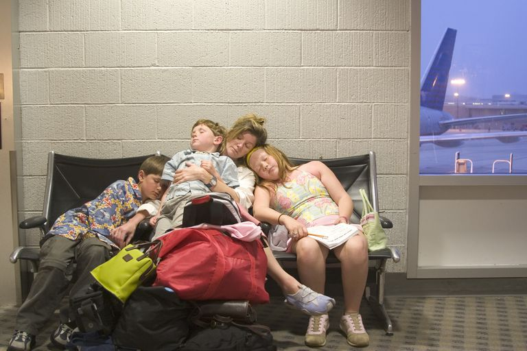 Family sleeping at airport