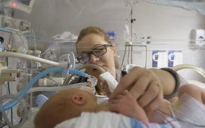 Newborn with mom in NICU