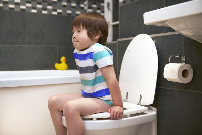 Four year old on the toilet