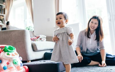 Baby walking around living room