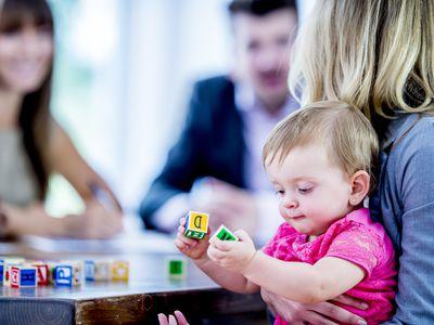 Parents interviewing babysitter