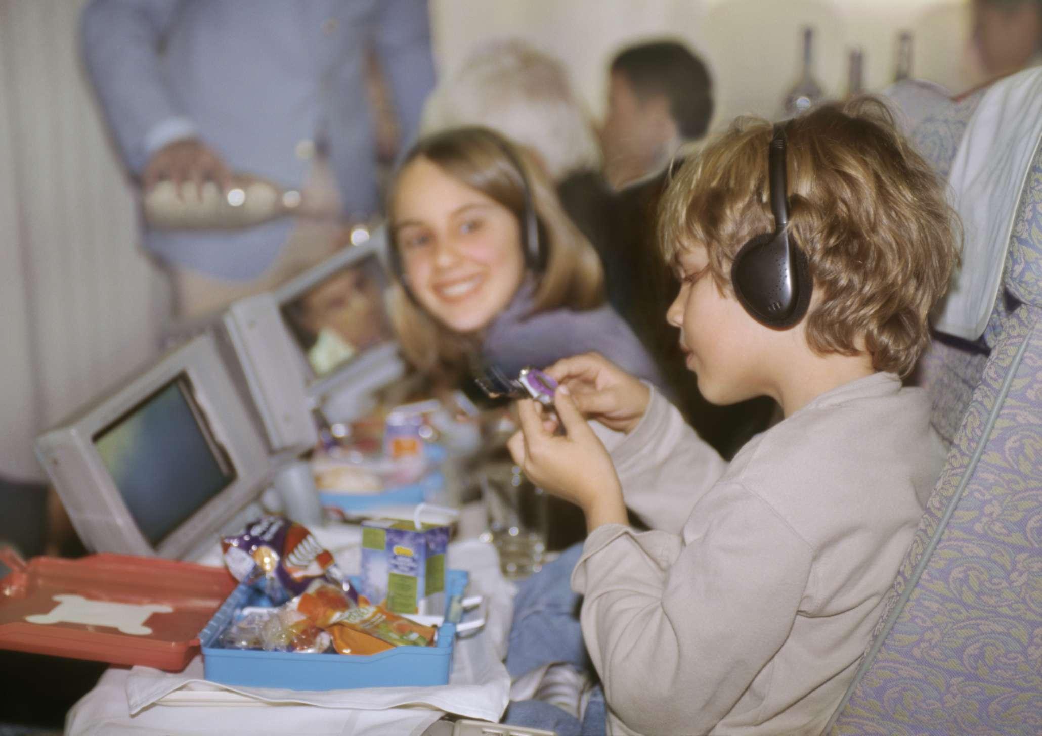 Children eating on plane