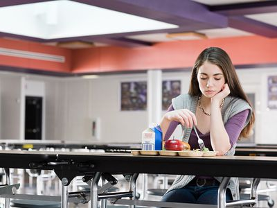Girl alone at lunch