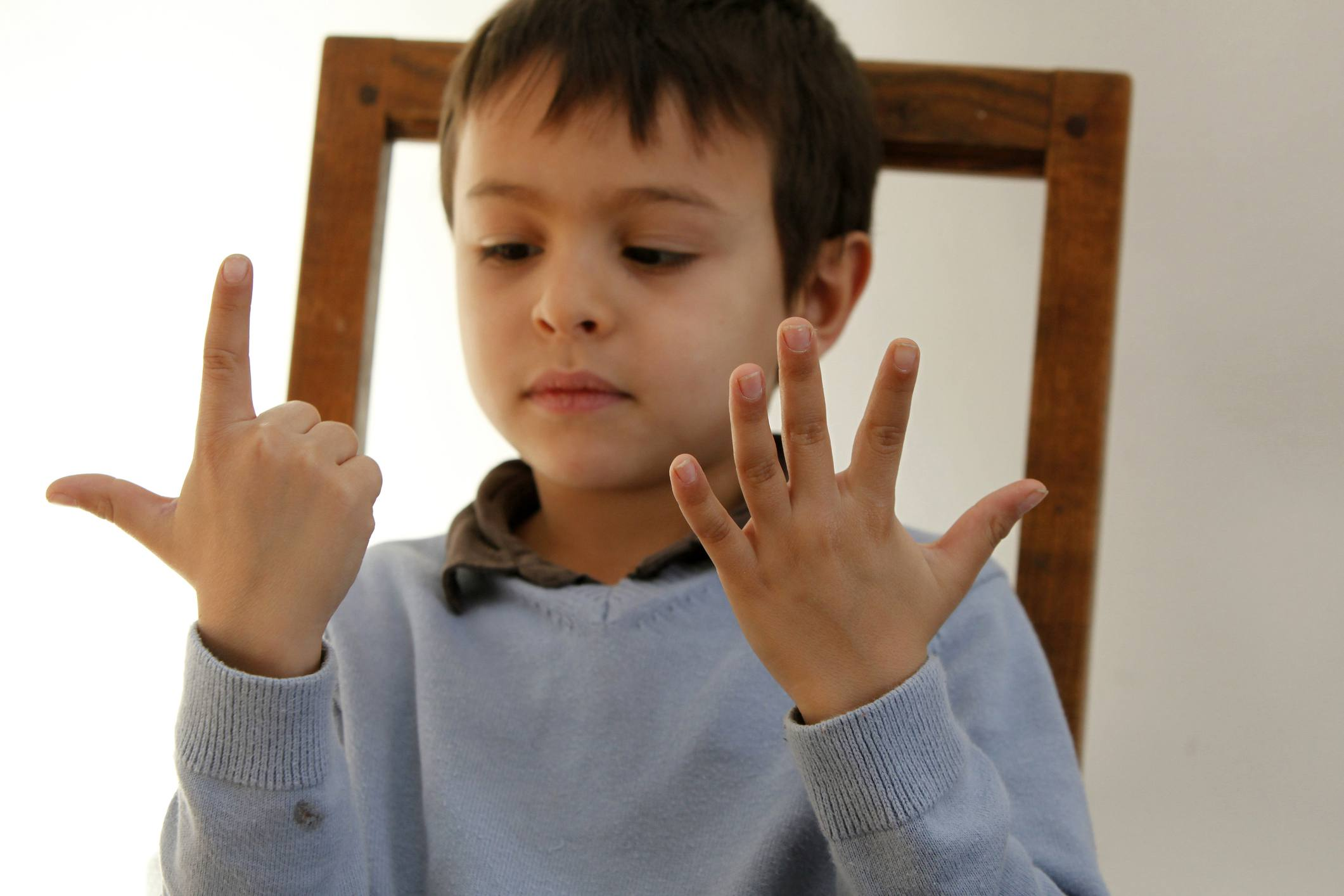 Child counting on fingers.