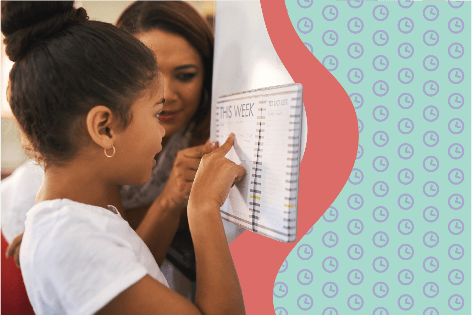 Girl looking at calendar with mother looking over her shoulder