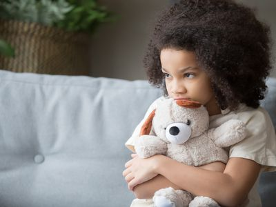 stressed out young child holding stuffed animal