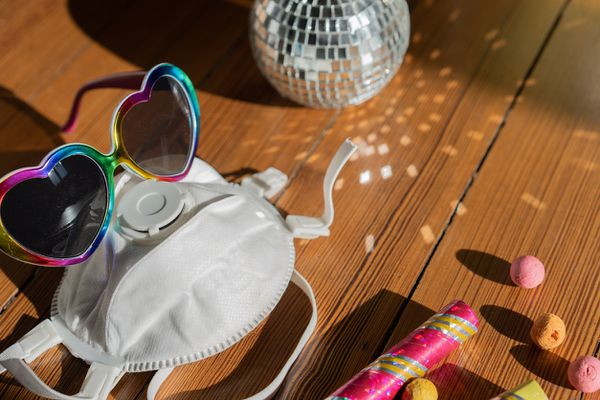 N95 Mask on table with party supplies
