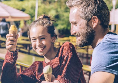 Dad and daughter eating ice cream