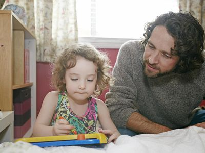 Father teaching toddler daughter