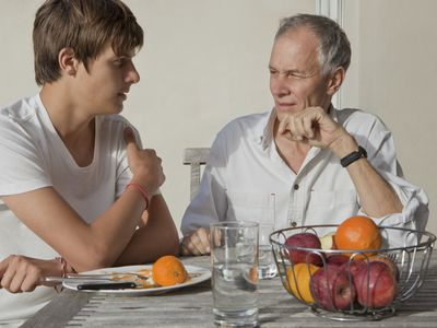 Father Talking With Teen