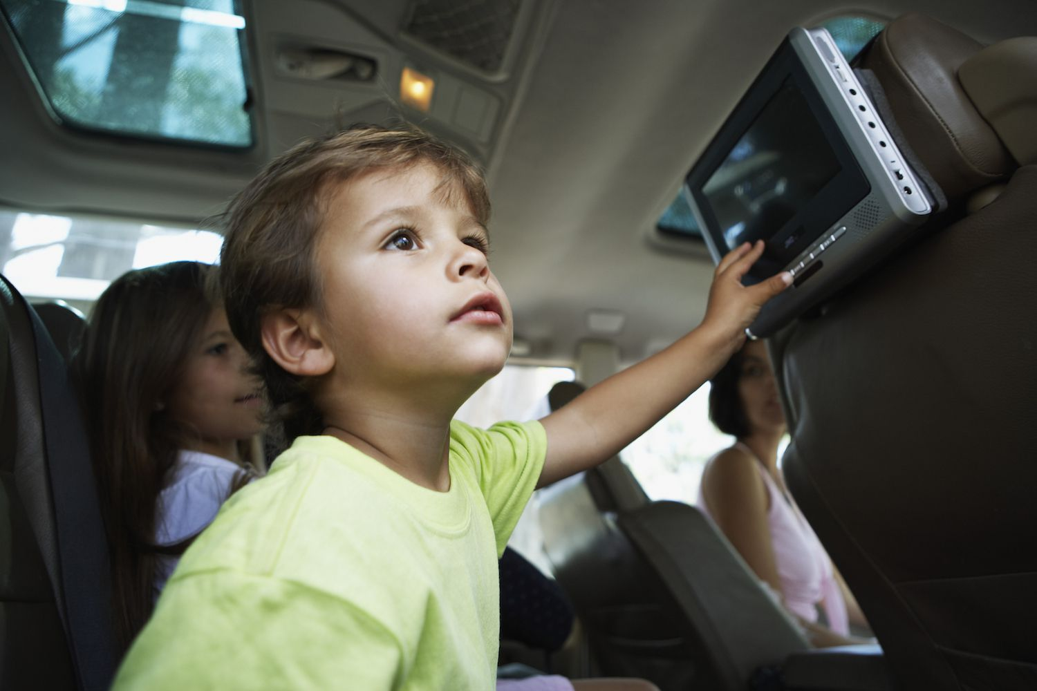 Children Watching Portable Television in MPV