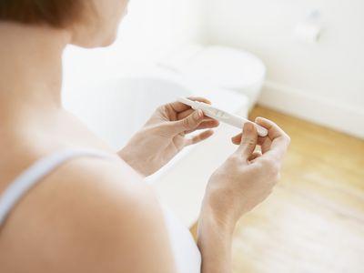 woman taking pregnancy test