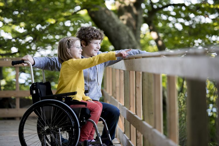 Boy and disabled girl at the park