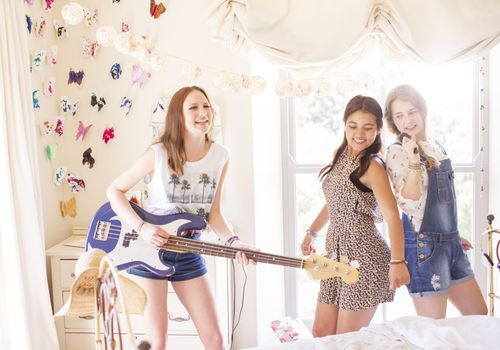 Girls playing guitar and singing