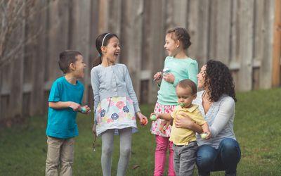 mother with 4 kids preparing for Easter egg hunt