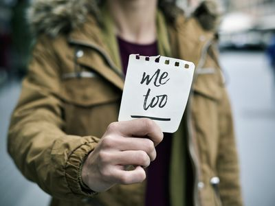 woman holding note with #MeToo