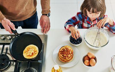 kid making pancakes
