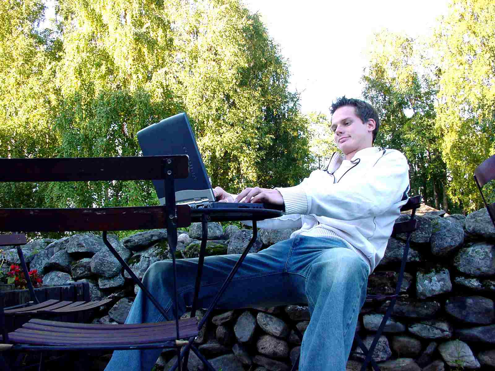 Man sitting with laptop on the table