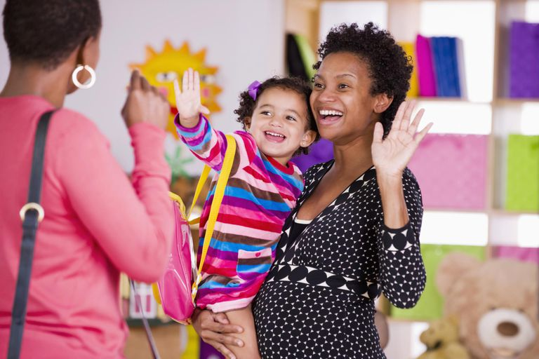 Mother and child waving to teacher