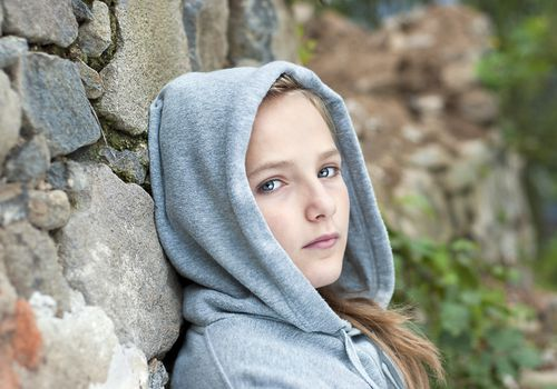 sad young girl in hoodie