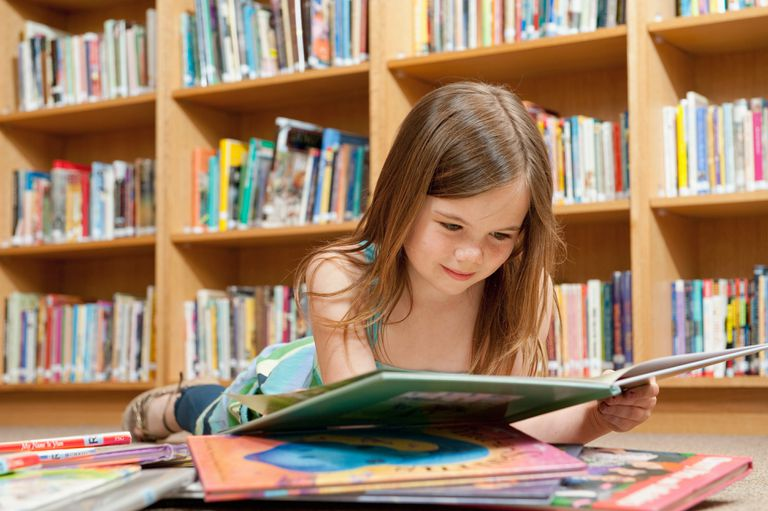 girl reading in library