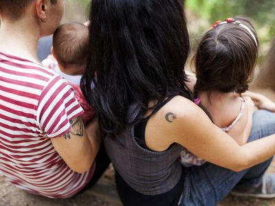 Back view of lesbian couple with two children
