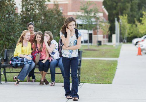 Girls bullying another girl