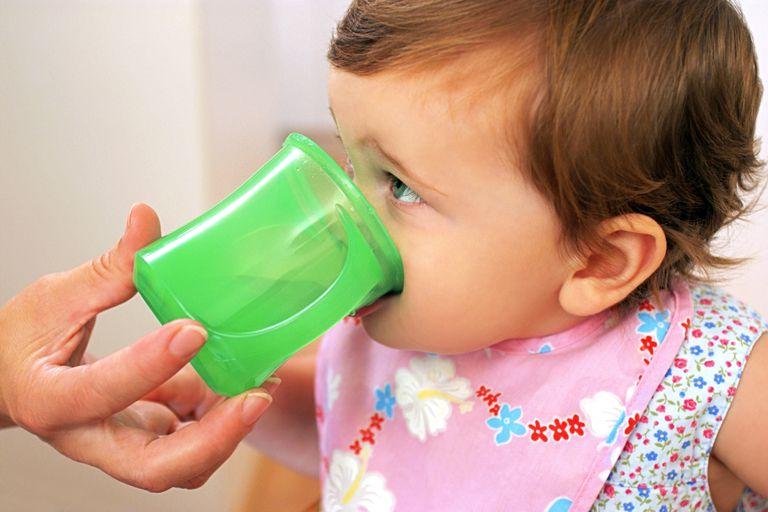 Cup feeding a baby