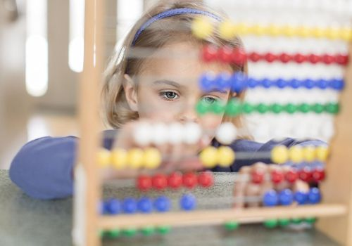 Young girl using abacus